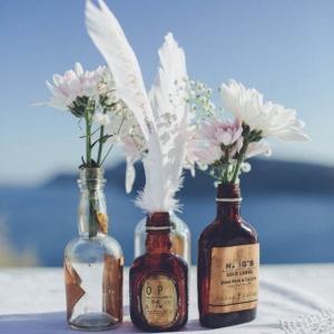 Feather & Brown Bottle Wedding Centerpiece