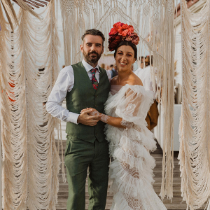 Ruffle wedding dress and macrame wedding backdrop