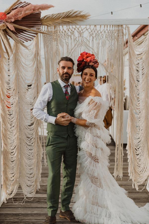 Ruffle wedding dress and macrame wedding backdrop