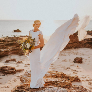 Chic coastal wedding bridal portrait on rocks