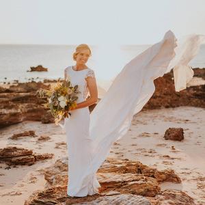 Chic coastal wedding bridal portrait on rocks