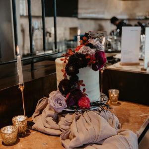 Modern romantic wedding cake with cascading fresh florals