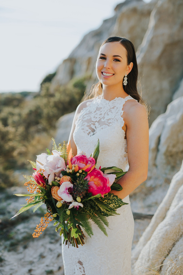 Bride with vibrant tropical bouquet
