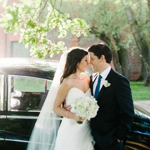 Newlyweds With Vintage Car