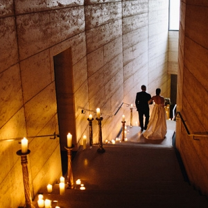 Bride Walking Down Candlelit Aisle