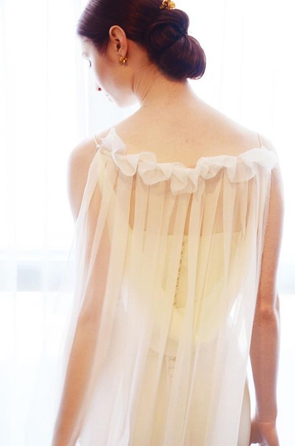 Bride Wearing Cape