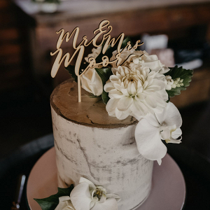 Semi naked wedding cake with laser cut topper