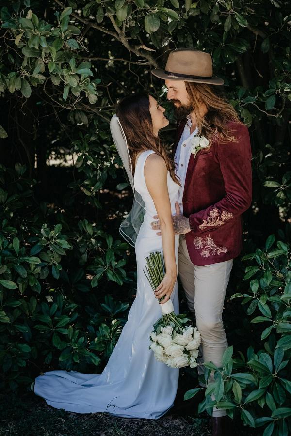 Australian bride and groom in velvet jacket
