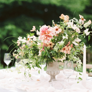 Classic urn wedding centerpiece with peach florals