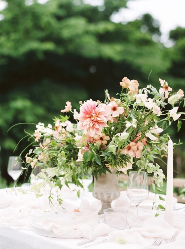 Classic urn wedding centerpiece with peach florals