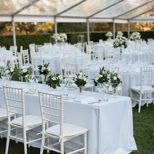 Classic white wedding reception with long tables