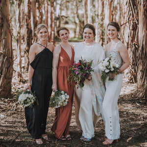 Mismatched bridesmaids in dresses and jumpsuits