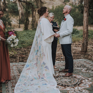 Bride with colorful sequin cape