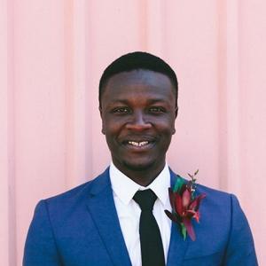 Groom In Blue Suit With Black Tie
