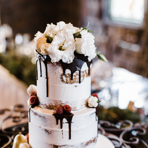 Semi naked drip wedding cake with fresh flower topper