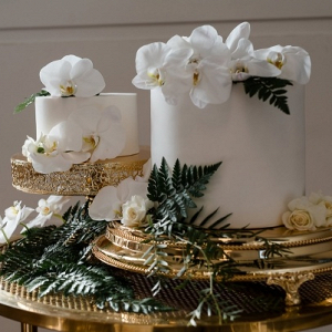 Small white wedding cakes with orchids