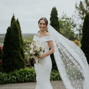 beb924f66677 Drip wedding cake; Off the shoulder wedding gown with polka dot veil ...