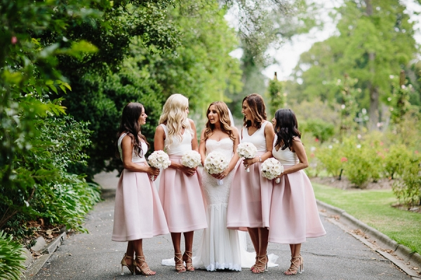 Bridesmaids In Pale Pink Skirts