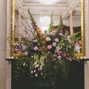 Elegant Floral Arrangement With Gold Mirror