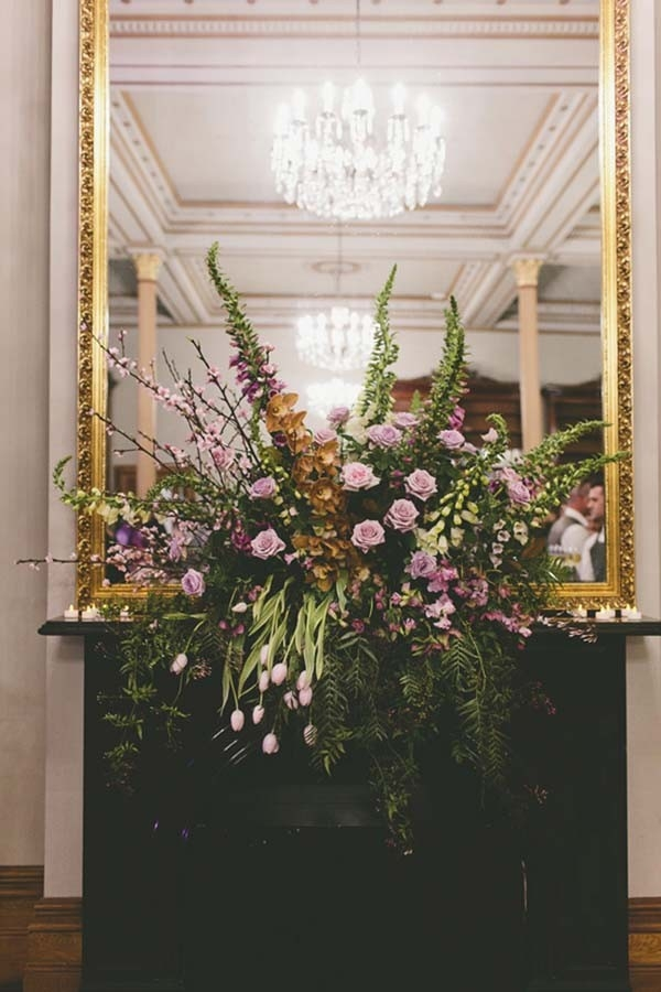 Elegant Floral Arrangement With Gold Mirror