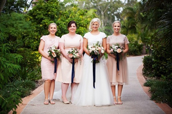 Bride With Bridesmaids In Peach And Navy