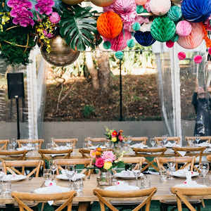 Colorful wedding reception with hanging poms