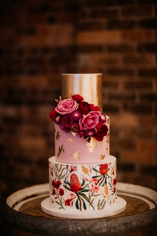 Floral print pink and gold wedding cake