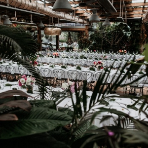 Tropical wedding reception with long tables