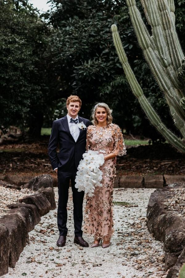 Bride in floral applique pink wedding dress