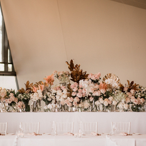Modern tropical floral backdrop at wedding reception