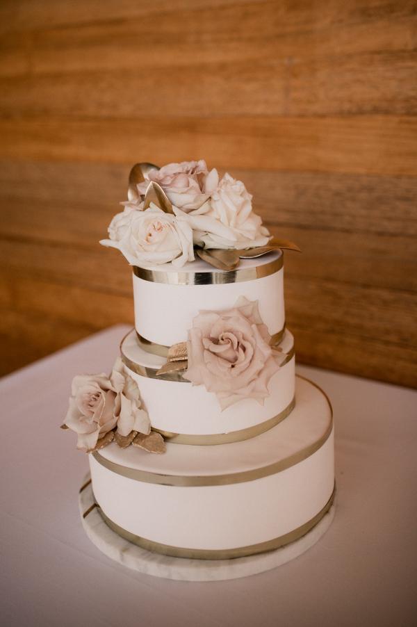 White wedding cake with gold trim