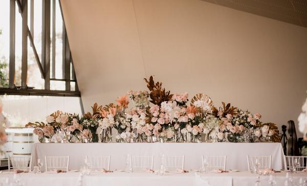 Modern tropical floral backdrop at wedding reception