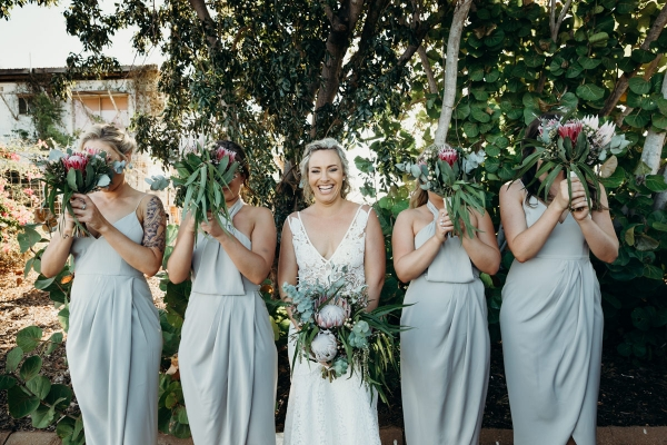 Bridesmaids in pale blue dresses