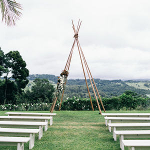 Outdoor wedding ceremony with boho backdrop