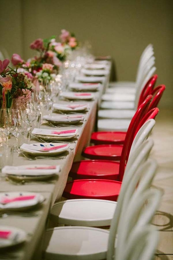 Neon Pink Chairs At Wedding Reception