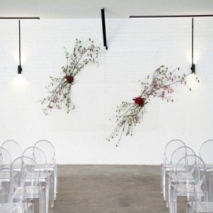 Modern ceremony with floral backdrop