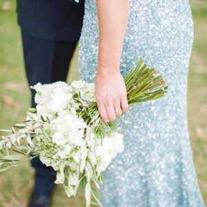 A White Bouquet With Pale Blue Sequn Gown