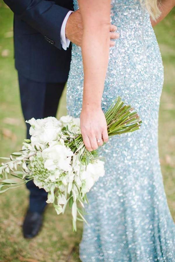 A White Bouquet With Pale Blue Sequn Gown