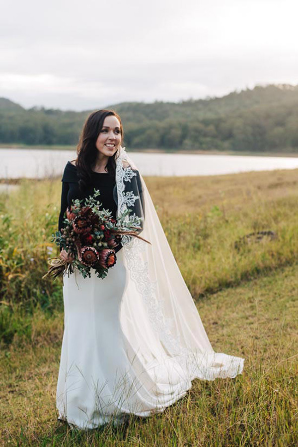 Bride In Black And White Wedding Dress