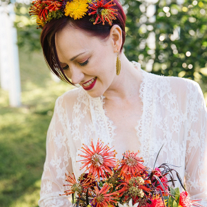 Bride with colorful floral crown and wild bouquet