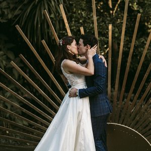 Outdoor wedding with gold sun backdrop