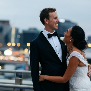 Happy Bride and Groom On Rooftop