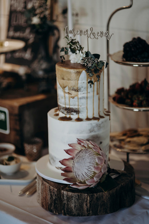 Drip wedding cake with laser cut cake topper
