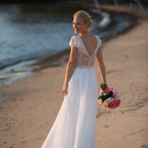 Bride Walking Along The Beach