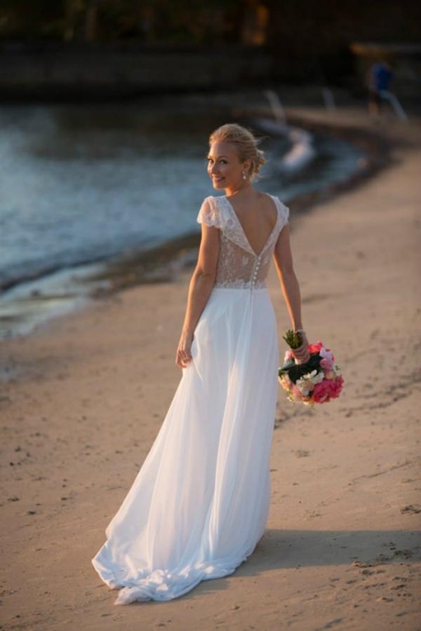 Bride Walking Along The Beach