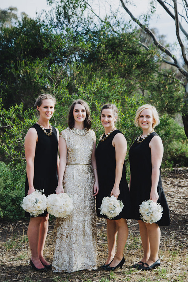 Bride In Gold With Black Bridesmaid Dresses