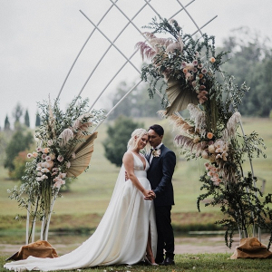 Epic modern boho wedding ceremony arch