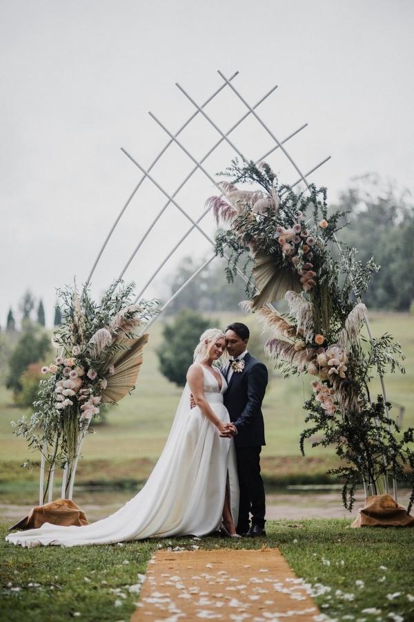Epic modern boho wedding ceremony arch