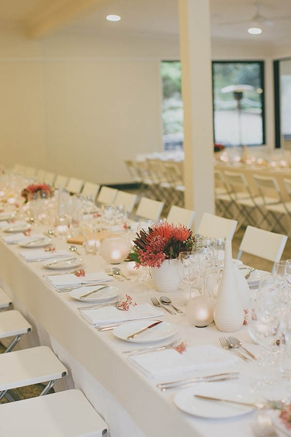 White Wedding Reception With Red Flowers