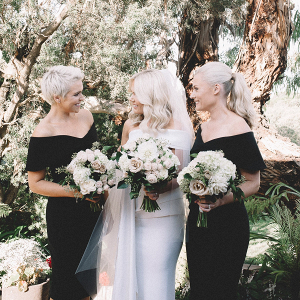 Bridesmaids in off the shoulder black dresses